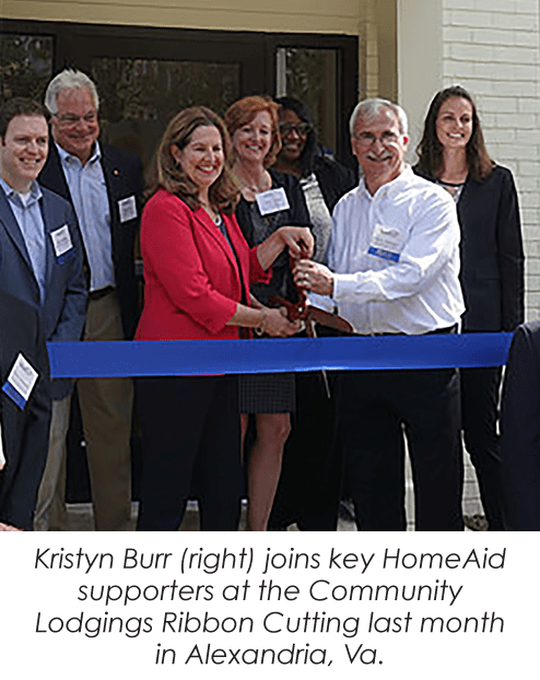ribbon cutting on front porch of new home