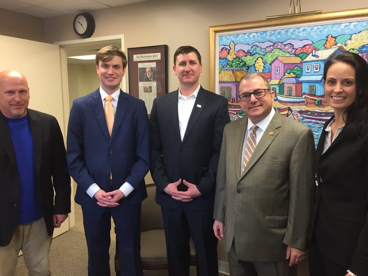 Pictured: Brian Davidson; Andrew Clark, vice president of government relations, Home Builders Association of Virginia; Mike Sandkuhler; Senator Adam Ebbin; and Kristyn Burr (left to right).