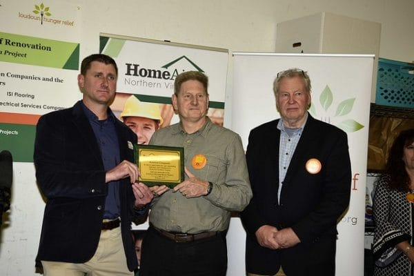 HomeAid President Mike Sandkuhler presents a plaque to Builder Captain Don Knutson and Ollin Toller of Knutson Companies at LHR's Open House.